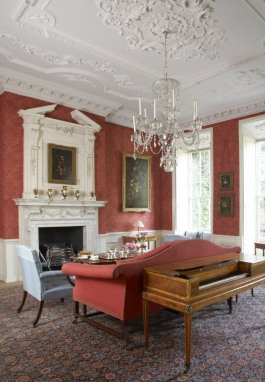 The Large Drawing Room at Mompesson House, Salisbury, Wiltshire. The marble chimneypiece and overmantel, known collectively as a continued chimneypiece, was installed by Charles Longueville in the eighteenth-century.